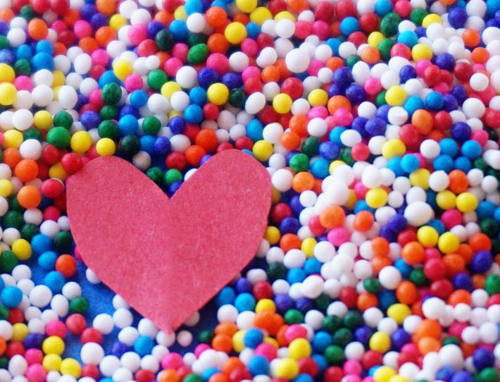 paper heart with multicoloured background